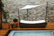 Swimming pool bed with sun cover